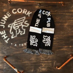 Black scarf with the June Cork Pub text in the middle and griffin on each end - folded
