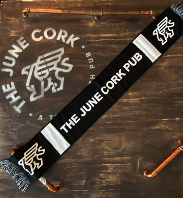 Black scarf with the June Cork Pub text in the middle and griffin on each end